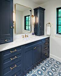 Dreaming Of Blue Hues This Remodeled Blue And Gold Bathroom With Patterned Tile From Boyer Bu Blue Bathroom Vanity Bathroom Remodel Small Budget Gold Bathroom