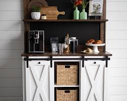 The floating shelves above provide even more storage to display a collection of dining items. Coffee Buffet Etsy