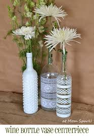 Upcycle wine bottles with this boho take on a fresh floral centerpiece.