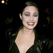 back in her dark edgy days angelina jolie went for the clownpaint approach pale skin high