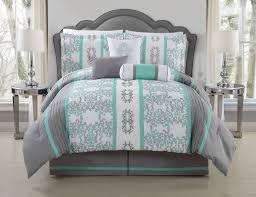 teal and gray bed cover