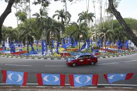 the lucky garden roundabout is decorated with multicoloured flags in bangsar may 3 2018