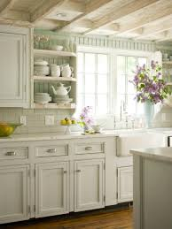 open kitchen design farmhouse: exposed ceiling beam design also farmhouse sink plus white cabinets with open shelves in chic cottage kitchen