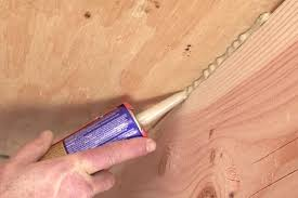 fix squeaky floors using construction adhesive