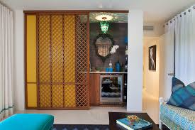 baroque sliding room dividers in family room midcentury with indian door next to home bar alongside sliding