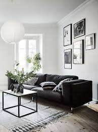 Living Room In Black White And Gray With Nice Gallery Wall Amazing White On White Living Room Decorating Ideas