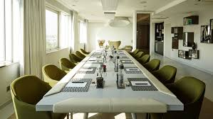 the luxurious and elegant business conference rooms. A Large Meeting Room Space Which Is Flooded With Natural Light From The Wall Of Luxurious And Elegant Business Conference Rooms