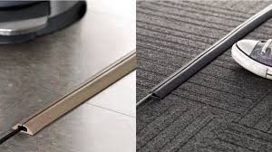 appealing grey and brown color Floor Cord Cover on the floors