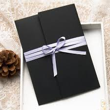elegant wedding invitations with ribbon wedding invitations Ribbon On Wedding Invitation elegant purple ribbon with heart pearl buckle layered wedding as well wedding invitations with ribbons invitesweddings tying a ribbon on a wedding invitation