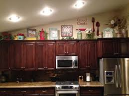 above kitchen cabinet lighting. The-best-solution-for-decorating-above-kitchen-cabinets -is-to-not-put-anything-up-there-except-a-736-x-552.jpg Above Kitchen Cabinet Lighting