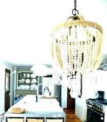 wood bead chandelier chandeliers fetching combine with aged beaded world market