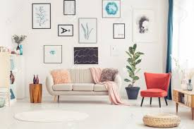 round rug and red armchair in colorful living room interior for with beige sofa brown cowhide grey ideas area size guide ikea on carpet rugs blue orange