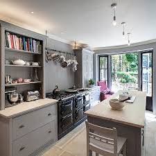 mixed cabinet styles coupled with open gray shelves give the kitchen a modern appeal design