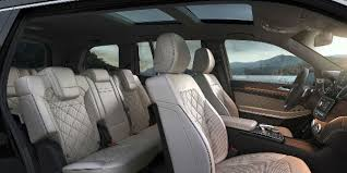 white 2018 mercedes benz gls rear interior with three rows of seating and panoramic sunroof