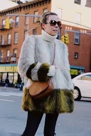 it seems to me that a faux fur coat and new york city go hand in hand winter in the city is like living on a ski resort for a couple of