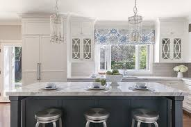 white cabinets with mullion glass doors
