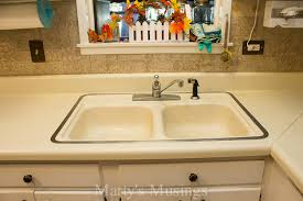 How To Install Or Replace A Universal Telescopic Bottle Trap For A How To Install A New Kitchen Sink