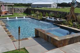This southwest style rustic pool and spa features geometric design, raised  basin with bubbler fountains  Swimming Pools BackyardSwimming ...