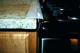 fill gap between stove and counter how to n dishwasher cabinet filling gaps cabinets kitchen 1