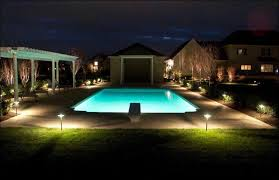 design ideas gorgeous landscape lighting beautify lavish home swimming pool that also decorated with green