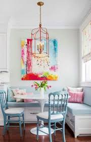 dining room table with upholstered bench. Small White Round Dining Table Pastel Blue Upholstered Bench And Chair Orange Copper Pendant Lights Red Striped Cushion Medium Wood Flooring Room With
