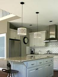 neutral kitchen with large island and granite counters chandeliers drum pendant lighting decorating design