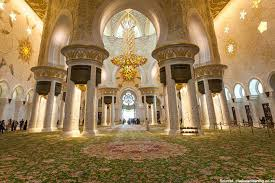 in the photo the floor carpet and the central chandelier from the main prayer hall of the sheikh zayed mosque are listed in the guinness book of records