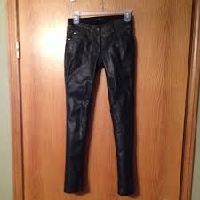 a pair of faux leather cigarette pants featuring a paneled front three pocket construction zip fly and two on closure with high polish finish