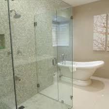 Green Mosaic Tile in Frameless Glass Shower
