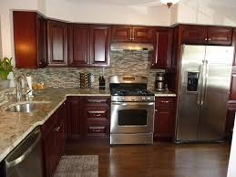 A Modern Kitchen Stainless Steel Appliances Granite Counter Tops Tile Back  Splash Mahogany Cabinets