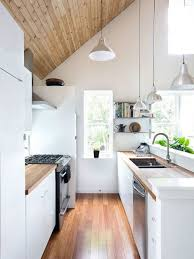 this is an example of a small scandi galley kitchen in london with a double