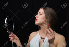 woman holding mirror. Modren Woman Beautiful Woman Applying Red Lipstick And Holding Mirror Stock Photo   50671503 Throughout Woman Holding Mirror L