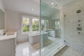 master bathroom with marble floors and tile shower