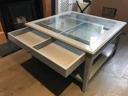grey ikea liatorp coffee table with display drawer