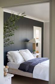 painted wood panel wall to make the room look taller