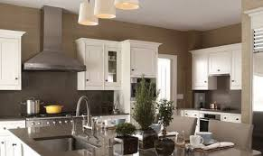 range wall of kitchen with white cabinets and dark neutral taupe walls -  Patrik Lonn via