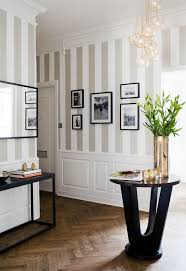 An elegant way of doing striped walls! The light colors keep the stripes  from being