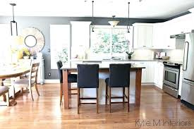 what color countertops go with maple cabinets open layout kitchen and dining subtle country farmhouse style
