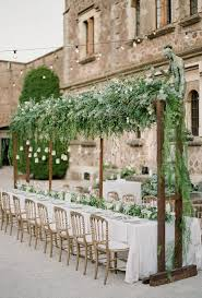 this head table feels even more intimate thanks to the greenery and hanging tea lights