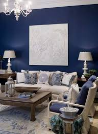 Blue accent wall with cream fabric and dark wood for living room Ultimate  Blue Guide
