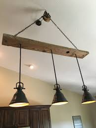 rustic wood beam chandelier distressed barn pulley vaulted ceiling