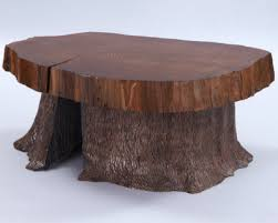 slab coffee table w carved tree trunk