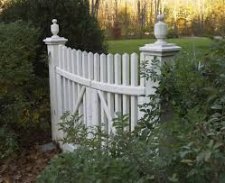 white fence ideas. A Row Of Manicured Hedges Acts As The Perimeter Fence, With An Aged White Picket Fence Ideas