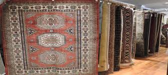 large selection of antiques moderns and tribal rugs