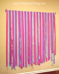to firmly secure the streamers run a strip of the masking tape sticky side down to the top and bottom of the backdrop