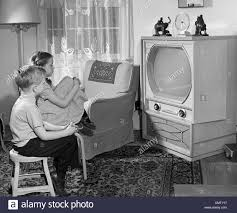 Living Room Set With Free Tv 1950s Boy And Girl Watching Tv In Living Room Stock Photo Royalty