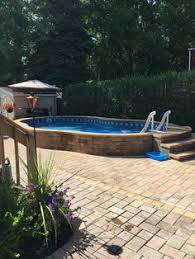 semi inground pool ideas. Radiant 14x22 Semi-Inground Freeform With Pavers Semi Inground Pool Ideas