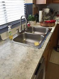 kitchen countertop paintA DIY countertop redo and a kitchen cabinet painting project  The