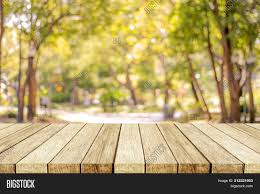 blurred outdoor backgrounds. Simple Outdoor PowerPoint Template With Blurred Nature Background Empty Wooden Table Over Blur  Park Outdoor  On Backgrounds R