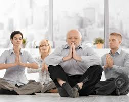 meditation office. Businesspeople Doing Meditation In Office With Closed Eyes, Hands Put Together, Concentrating. Stock